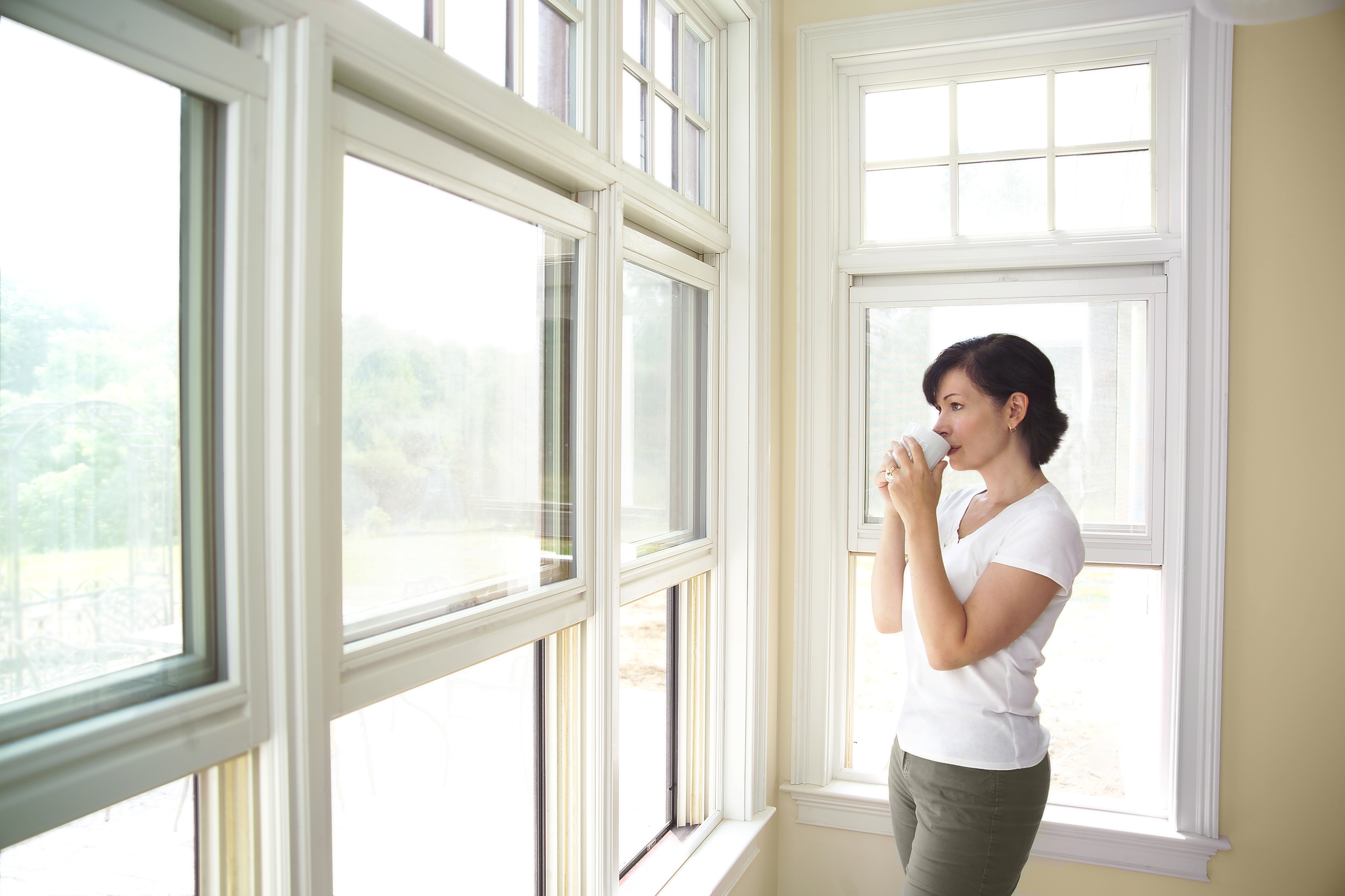 Woman looking out of Double Glazed Window